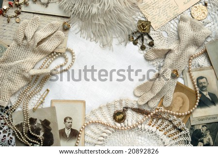 Vintage bordering with white crocheted gloves - stock photo