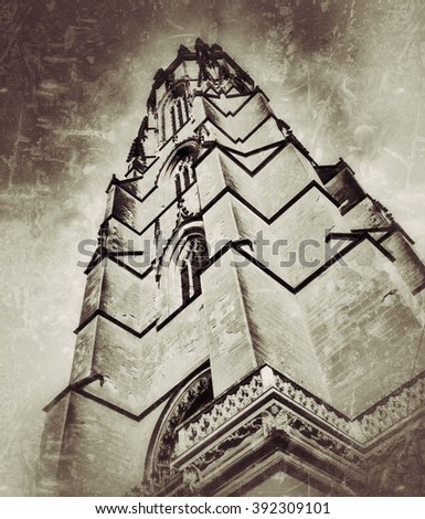 Vintage bottom-up view of the St-Nicolas cathedral in Fribourg (Switzerland) - stock photo
