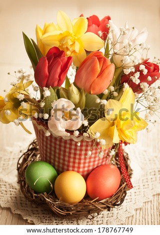 Vintage Bouquet of spring flowers and easter eggs for Easter - stock photo