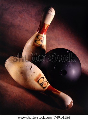 VINTAGE Bowling ball and two pins very shallow depth of field - stock photo