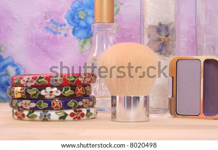 Vintage Bracelets and Cosmetics on Vanity, Shallow DOF, Focus on Eyeshadow and  Bath Products - stock photo