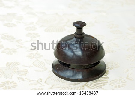 Vintage brass bell from a hotel reception - stock photo