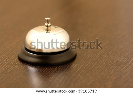 vintage brass bell on hotel bellstand