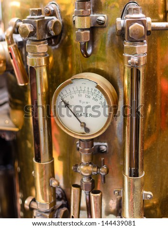 Vintage brass pressure gauge previously used on vintage fire trucks in England, UK - stock photo