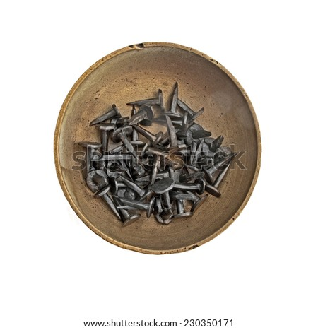 vintage brass tray with tacks nails over white, clipping path - stock photo