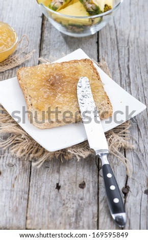 Vintage Breakfast table with a fresh made Pineapple Jam Sandwich - stock photo