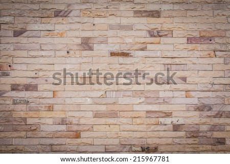 vintage brick wall with soft vignette - stock photo