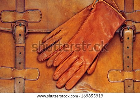 Vintage briefcase with gloves - stock photo