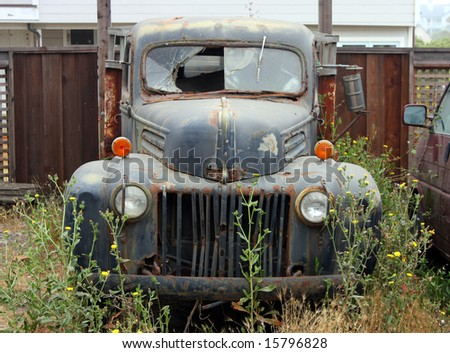 vintage broken down car - stock photo