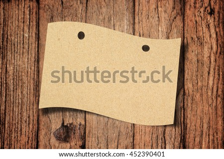 Vintage Brow Paper on Wood Background