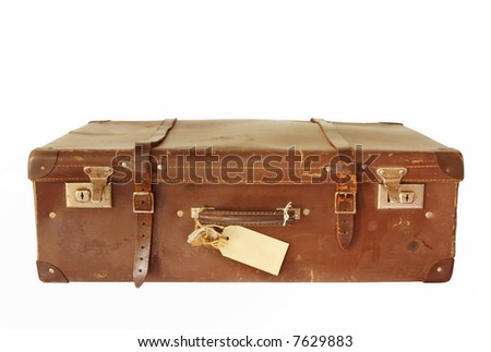 Vintage brown leather suitcase, isolated on white.  With blank luggage tag. - stock photo