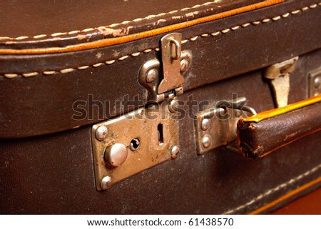 vintage brown suitcase with open lock