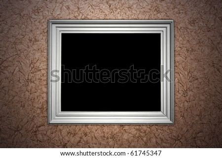 vintage brown wall with empty picture frame hanging on it - artistic shadows added - stock photo