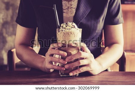 vintage business woman and frappe coffee drink - stock photo