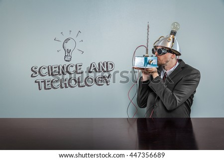 Vintage businessman concept wearing futuristic helmet at office