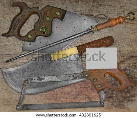 vintage butcher shop tools over stained wooden table,space on business card for your text - stock photo