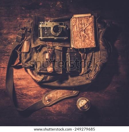 Vintage camera and handbag on wooden background  - stock photo