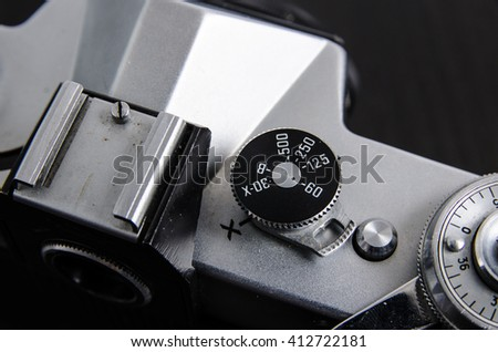 Vintage camera close up.black background. Shutter speed dial. - stock photo