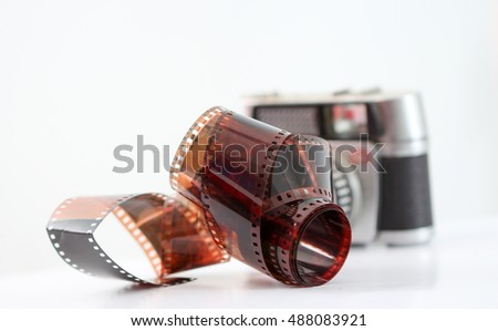 vintage camera film roll on white background