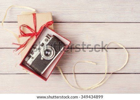 Vintage camera in red gift box, top view - stock photo