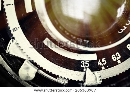 Vintage camera lens close-up - stock photo