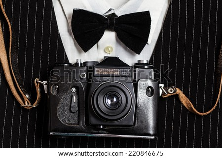 Vintage camera on background of the suit - stock photo