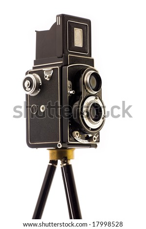 Vintage Camera on tripod over white background - stock photo