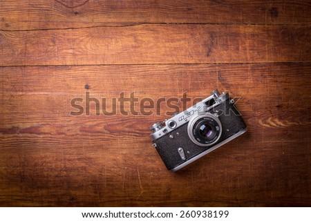 Vintage camera on wooden background - stock photo