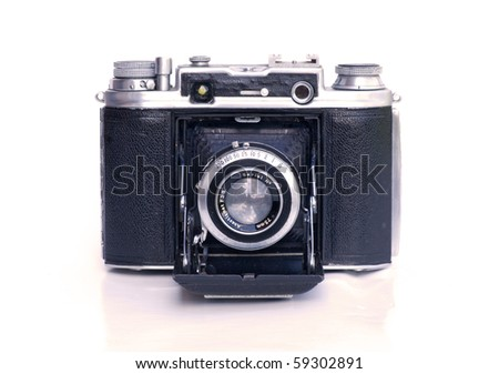 vintage camera with bellows on white background