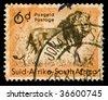 Vintage canceled postage stamp with lion illustration. South Africa, Johannesburg, 1958. - stock