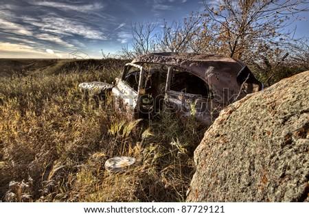 Vintage Car abandoned bullet holes target practice Saskatchewan - stock photo