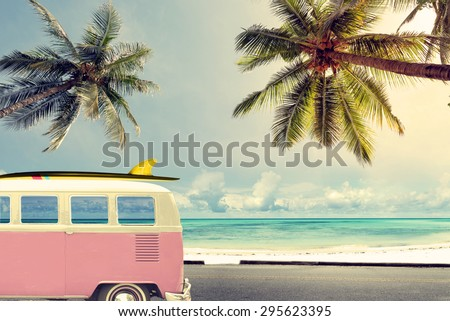 Vintage car on the beach with a surfboard  - stock photo
