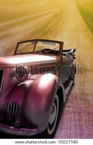 vintage car on the road - stock photo