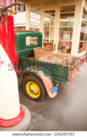 Vintage 1920 car parked on old style gas station - stock photo