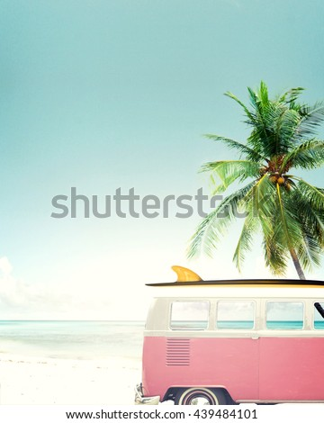 Vintage car parked on the tropical beach (seaside) with a surfboard on the roof - stock photo