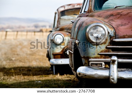 vintage car - two abandoned vintage cars in rural wyoming - stock photo