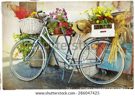 vintage card with bike and flowers - stock photo