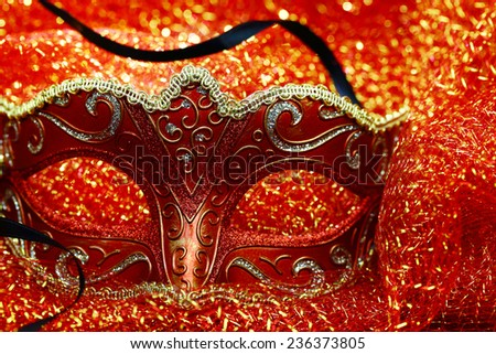 Vintage carnival mask in front of glowing background - stock photo