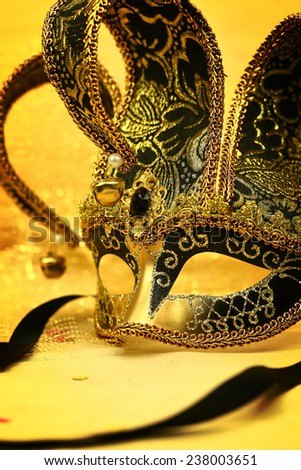 Vintage carnival mask in glittering background - stock photo