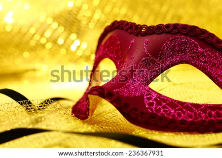Vintage carnival mask in golden background - stock photo
