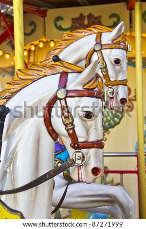 Vintage carousel or merry-go-round - stock photo