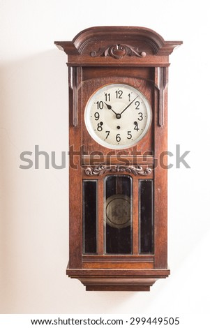 vintage carved wooden wall clock - stock photo
