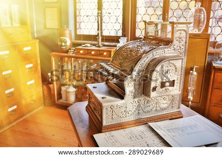 Vintage cash register in an old pharmacy - stock photo