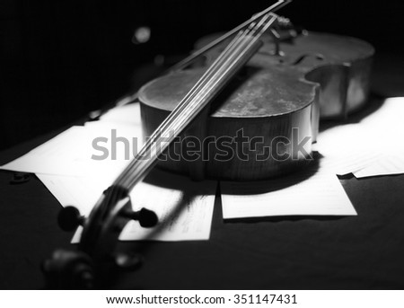 Vintage cello on wooden background. black and white photo