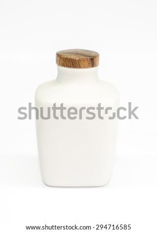 Vintage ceramic bottle with wooden lid isolated on white background