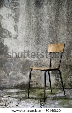 vintage chair over a grunge background