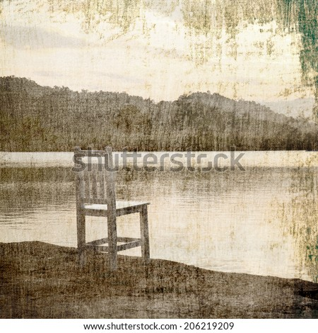 Vintage chairs on lake - stock photo