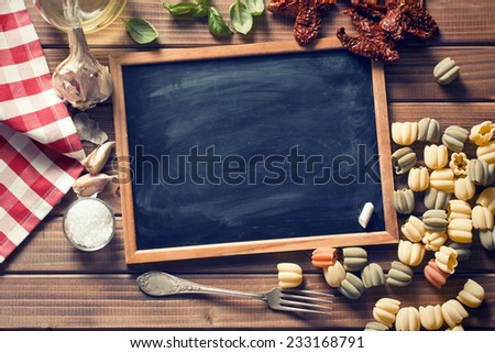 vintage chalkboard and italian food ingredients - stock photo