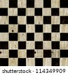 Vintage checkered chess board background. - stock photo