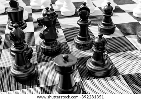 Vintage chessboard close up. Black and white photo - stock photo